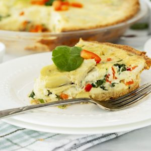 Slice of Baked Artichoke Quiche on a Plate
